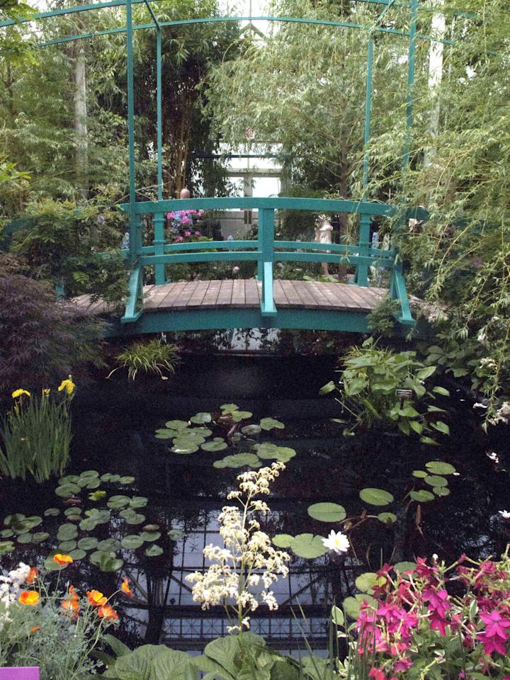 "In this May 26, 2012 photo, a replica of a bridge on the property of artist Claude Monet's home is featured in an exhibition at the New York Botanical Garden in New York. ""Monet's Garden,"" evokes the artist's garden at Giverny, his home in France from 1883 until his death in 1926. The exhibit runs through Oct. 21. (AP Photo/Ray Stubblebine)"