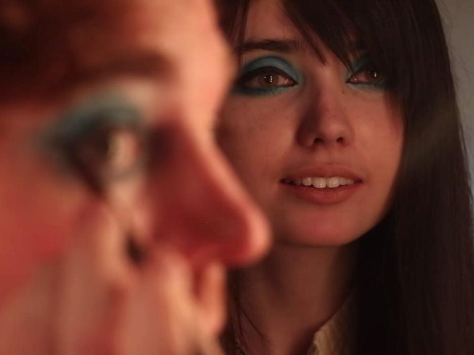 Shane Dawson putting on makeup with Eugenia Cooney.