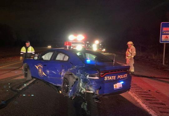 A crashed state police car is seen in Eaton County