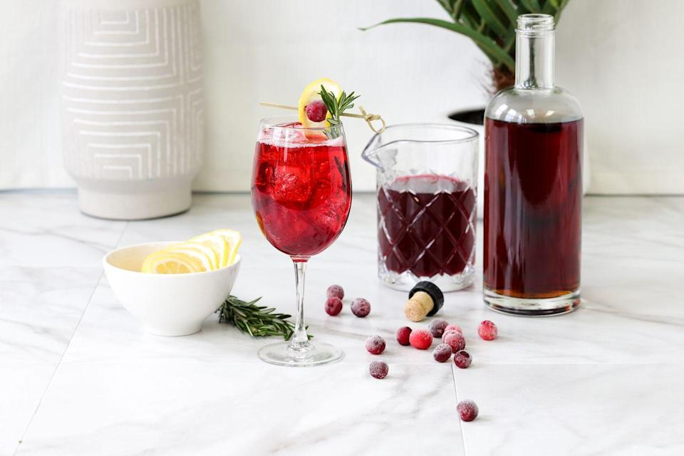 """<p>Cranberry juice and bitters with a spritz of soda make this drink perfect for your next brunch buffet or Thanksgiving aperitif.</p><p><strong>Ingredients:</strong></p><p>1.5 oz VSOP Cognac<br>2 oz organic unsweetened cranberry juice3 oz <br><a href=""""https://hellacocktail.co/"""" rel=""""nofollow noopener"""" target=""""_blank"""" data-ylk=""""slk:Hella Bitters & Soda Spritz"""" class=""""link rapid-noclick-resp"""">Hella Bitters & Soda Spritz<br></a>Two whole cranberries, rosemary sprig, and a lemon wheel for garnish</p><p><strong>Directions:</strong></p><p>Fill a highball glass or white wine glass with ice. Add Cognac and cranberry Juice. Top with Bitters & Soda. Garnish with cranberry skewer, rosemary, and lemon wheel.</p>"""