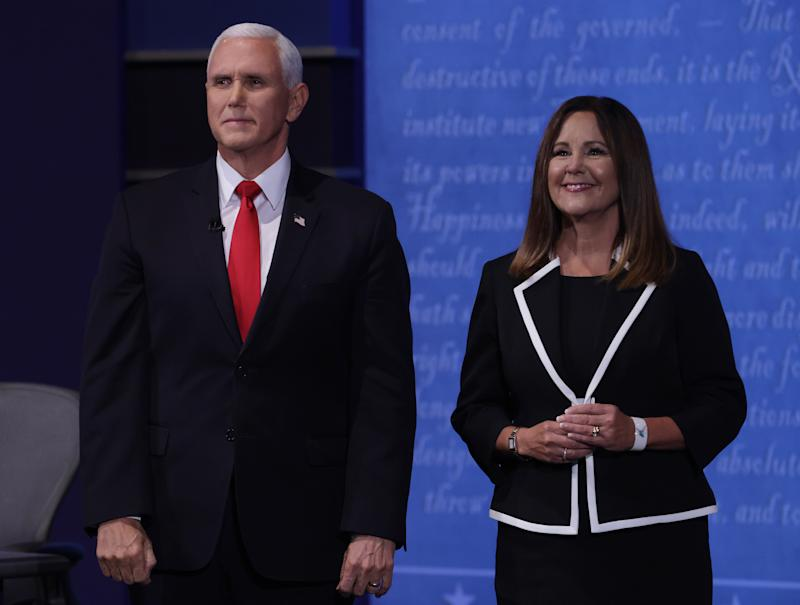 SALT LAKE CITY, UTAH - OCTOBER 07: U.S. Vice President Mike Pence and wife Karen Pence appear on stage after the vice presidential debate against Democratic vice presidential nominee Sen. Kamala Harris (D-CA) at the University of Utah on October 7, 2020 in Salt Lake City, Utah. The vice presidential candidates only meet once to debate before the general election on November 3. (Photo by Alex Wong/Getty Images)
