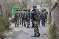 An Indian army soldier stands guard near the site of a gun battle on the outskirts of Srinagar, Indian controlled Kashmir, Sunday, Nov. 1, 2020. According to police, Indian government forces killed Saifullah Mir, a top rebel commander of the region's largest rebel group, Hizbul Mujahideen which has spearheaded an armed rebellion against Indian rule for decades. (AP Photo/ Dar Yasin)
