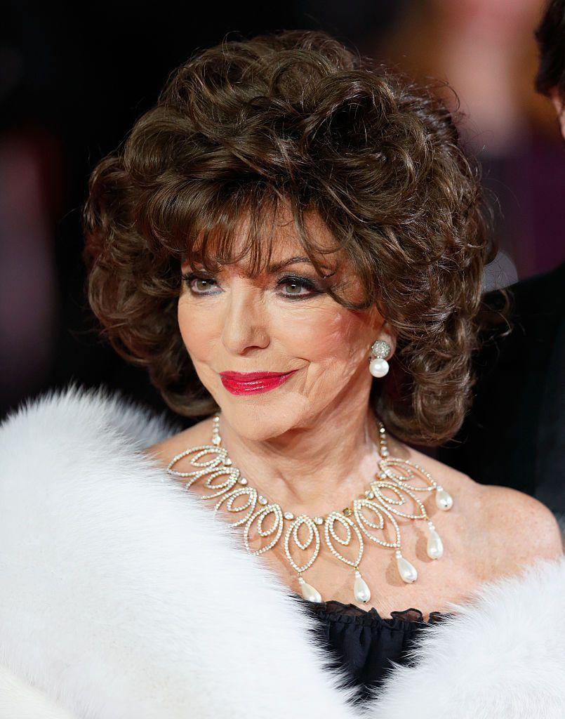 <p>Collins looked every inch the fabulous Bond girl in a pearl-drop necklace and earrings at the Royal Albert Hall. </p>