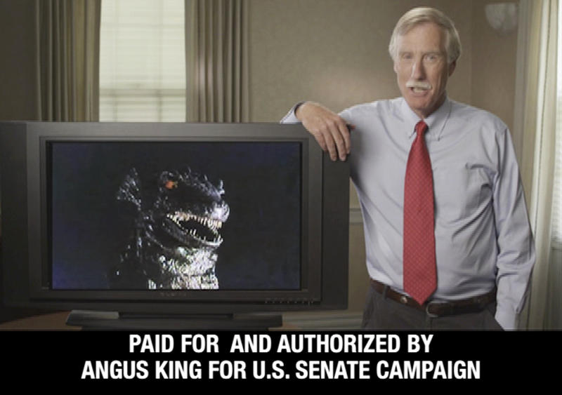 This still frame from a campaign video advertisement released by the Angus King for Senate campaign, shows King in Maine, with an image of Godzilla on a monitor. King, an independent and former governor, says his opponents are trying to portray him as a monster in the race for the November general election.  (AP Photo/Angus King for Senate campaign)