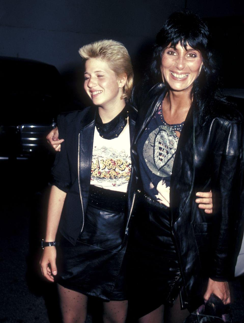 <p>Cher and Chaz Bono wear leather jackets and skirts while dining in West Hollywood, California. </p>