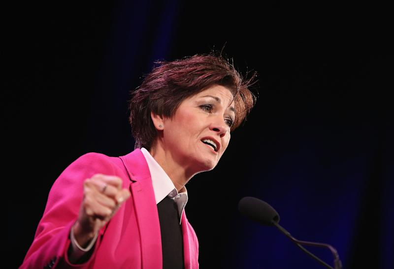 """Kim Reynolds, Iowa's Republicangovernor, says Obamacare is""""unworkable."""" But it has worked much better instateswhere officials support it. (Scott Olson via Getty Images)"""