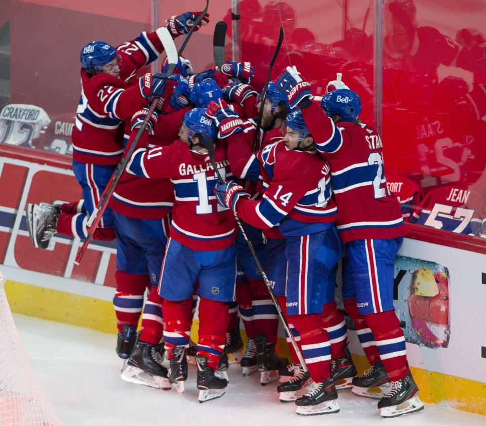 Montreal Canadiens players celebrate after defeating the Vegas Golden Knights following overtime in Game 6 of an NHL hockey Stanley Cup semifinal playoff series Thursday, June 24, 2021 in Montreal. (Ryan Remiorz/The Canadian Press via AP)