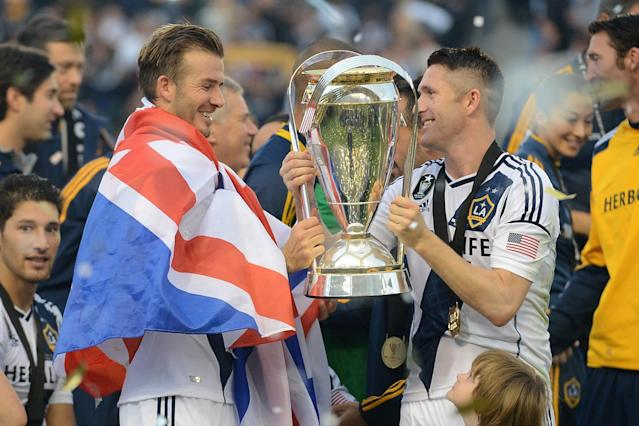 CARSON, CA - DECEMBER 01: David Beckham #23 and Robbie Keane #7 of Los Angeles Galaxy celebrate the 3-1 victory against the Houston Dynamo to win the 2012 MLS Cup at The Home Depot Center on December 1, 2012 in Carson, California. (Photo by Harry How/Getty Images)
