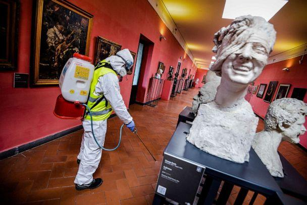 PHOTO: A worker sprays disinfectant to sanitize against coronavirus in a museum in Naples, Italy, March 10, 2020. (Alessandro Pone/LaPresse via AP)