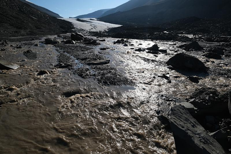 LONGYEARBYEN, NORWAY - JULY 31: Meltwater rushes down from the shrinking Longyearbreen glacier during a summer heat wave on Svalbard archipelago on July 31, 2020 near Longyearbyen, Norway. Svalbard, located far north of the Arctic Circle, is experiencing temperatures far above average that led to a new record high for the town of Longyearbyen on July 25 with 21.7 degrees Celsius. (Photo by Sean Gallup/Getty Images)
