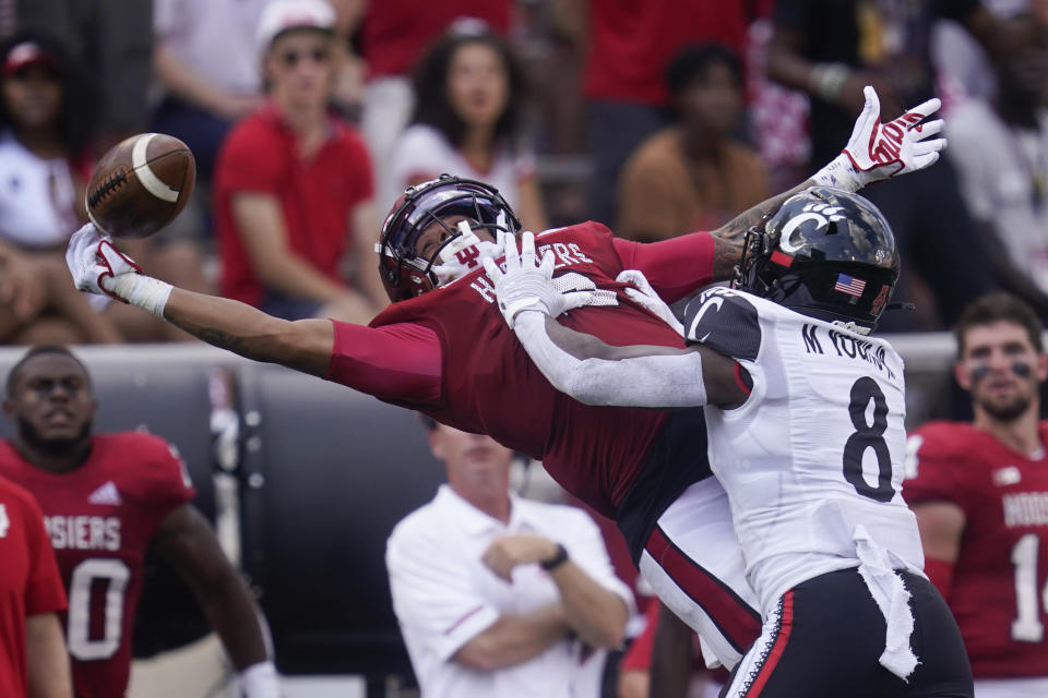 Indiana's Reese Taylor (2) tries to intercept a pass intended for Cincinnati's Michael Young Jr. (8) during the second half of an NCAA college football game, Saturday, Sept. 18, 2021, in Bloomington, Ind. Cincinnati won 38-24. (AP Photo/Darron Cummings)