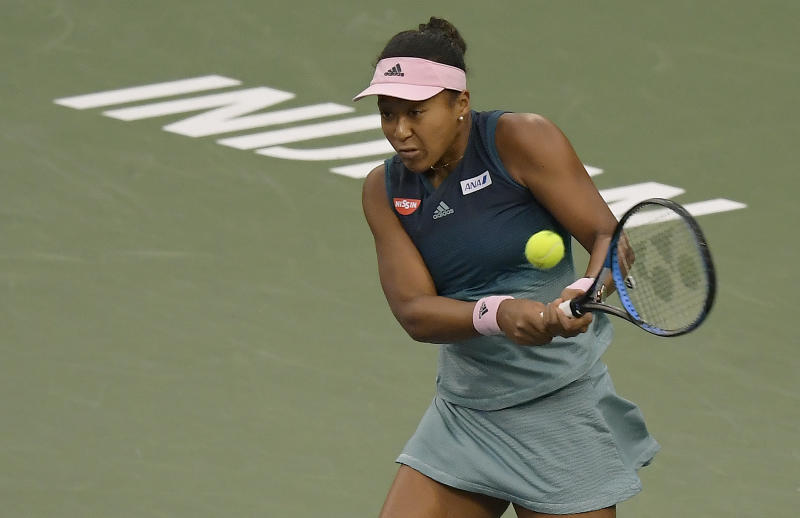 Naomi Osaka, of Japan, returns a shot to Danielle Collins at the BNP Paribas Open tennis tournament Monday, March 11, 2019, in Indian Wells, Calif. (AP Photo/Mark J. Terrill)