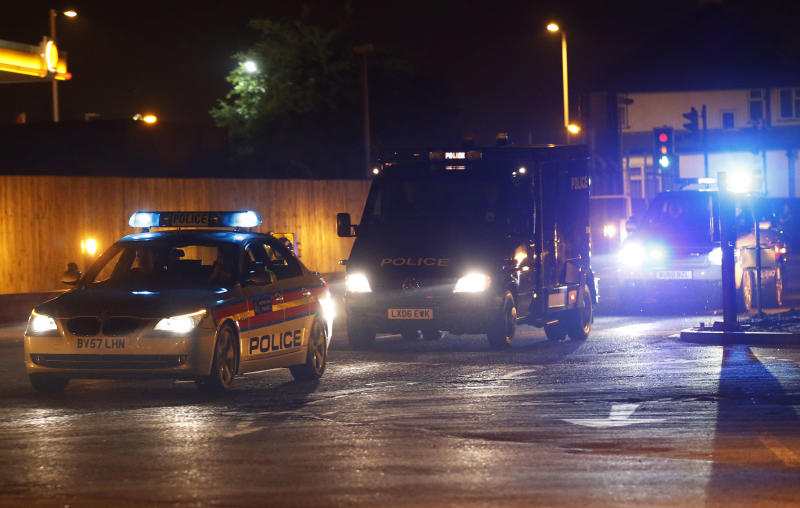 A police van carrying radical cleric Abu Qatada arrives, under escort, at RAF Northolt in London for his deportation to Jordan where he faces a retrial for his alleged involvement in terrorist plots, Sunday, July 7, 2013. Qatada's deportation was approved after Britain and Jordan signed a treaty agreeing that evidence obtained through torture would not be used against him at his retrial. (AP Photo/Sang Tan)