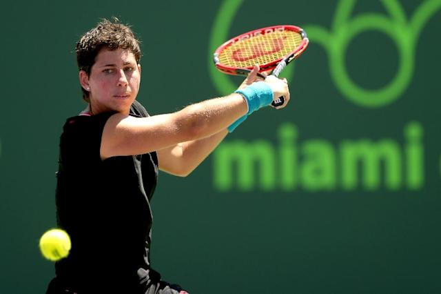 Carla Suarez Navarro of Spain returns a shot to Serena Williams during the final on day 13 of the Miami Open on April 4, 2015 in Key Biscayne, Florida (AFP Photo/Matthew Stockman)
