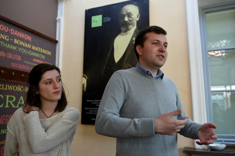 A portrait of Esperanto creator Ludwik Zamenhof looks over Przemyslaw Wierzbowski, Esperanto association president in Bialystok and French student Amelie Chartier, who volunteers at a body to promote the synthetic language