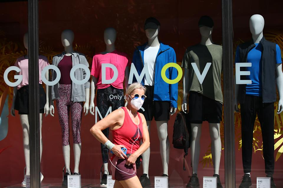 A pedestrian wearing a face covering walks past a shop on Oxford Street  (Getty Images)