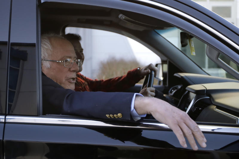 Democratic presidential candidate Sen. Bernie Sanders, I-Vt., departs Burlington International Airport after disembarking from a plane in South Burlington, Vt., on  Saturday, Oct. 5, 2019. (AP Photo/Steven Senne)