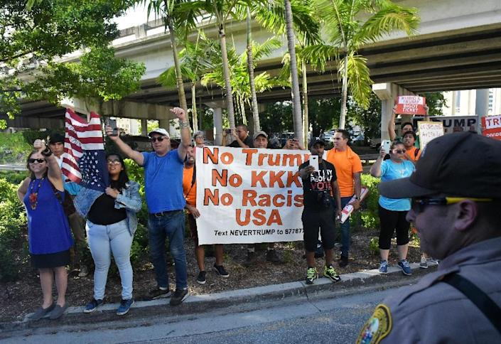 Protestors are seen ahead of a rally by Republican presidential nominee Donald Trump at the James L. Knight Center in Miami, Florida on September 16, 2016 (AFP Photo/Mandel Ngan)