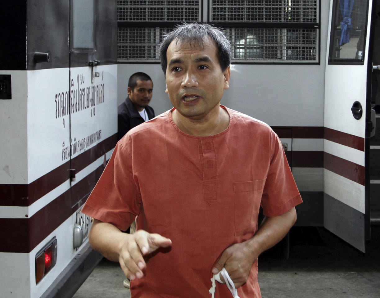 Thai-born American Joe Gordon gestures as he answers a reporter's question upon his arrival at a criminal court in Bangkok, Thailand, Thursday, Dec. 8, 2011. The court sentenced Gordon to two and a half years in prison Thursday for defaming the country's royal family by translating excerpts of a locally banned biography of the king and posting them online. (AP Photo/Apichart Weerawong)