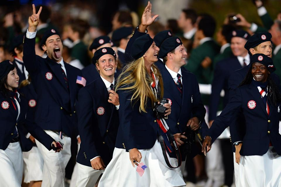 <p>Ralph Lauren kept it classic at the London opening ceremonies, dressing USA's greatest athletes in navy berets and matching jackets. Gold detailing and crisp, white accents finished off the tailored look. </p>