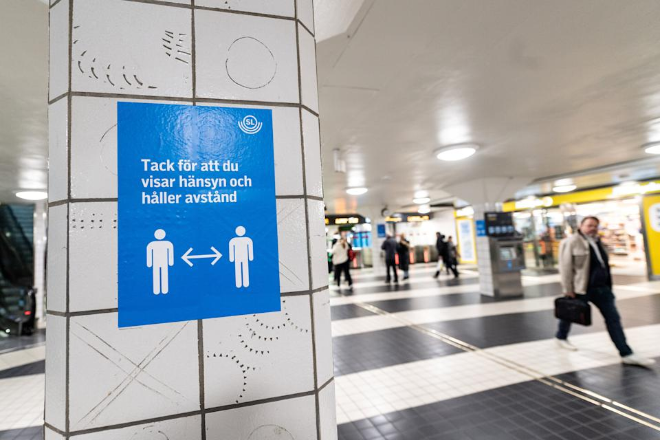 A sign reminding people to respect social distancing is seen amid the coronavirus disease (COVID-19) outbreak, at the Central Station in Stockholm, Sweden November 09, 2020. TT News Agency/Amir Nabizadeh via REUTERS      ATTENTION EDITORS - THIS IMAGE WAS PROVIDED BY A THIRD PARTY. SWEDEN OUT. NO COMMERCIAL OR EDITORIAL SALES IN SWEDEN.