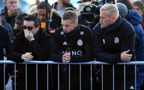 <span>Aiyawatt Srivaddhanaprabha, Jamie Vardy and goalkeeper Kasper Schmeichel look at the tributes outside the King Power Stadium</span> <span>Credit: PA </span>