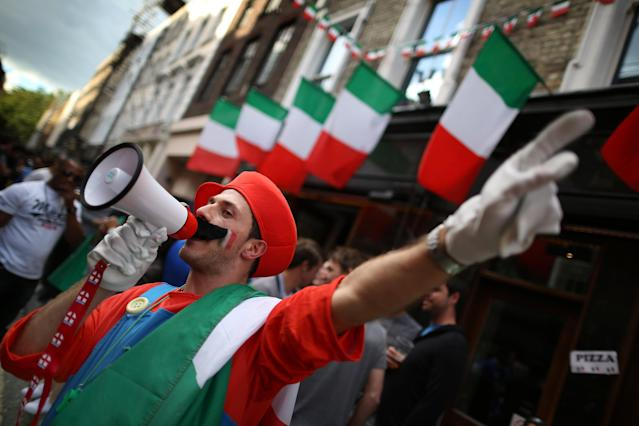 LONDON, ENGLAND - JULY 01: A football fan dressed as a Super Mario character gestures to other fans outside the Little Italy bar ahead of the screening of the UEFA EURO 2012 final football match on July 1, 2012 in London, England. London's large Spanish and Italian communities are preparing to watch the final. (Photo by Peter Macdiarmid/Getty Images)