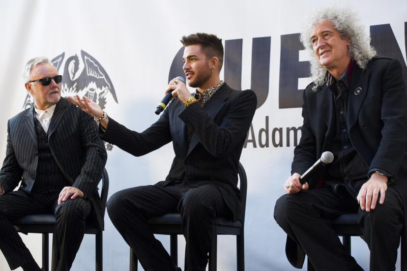 From left, Roger Taylor,, Adam Lambert and Brian May announce a Queen + Adam Lambert summer tour, on Thursday, March 6, 2014 in New York. (Photo by Charles Sykes/Invision/AP)
