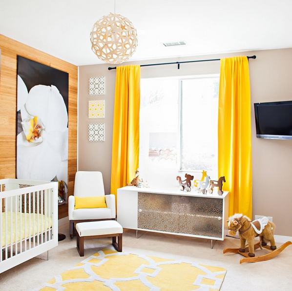 "<p>With the help of celebrity nursery designer <a rel=""nofollow"" href=""http://www.VanessaAntonelli.com"">Vanessa Antonelli</a>, the reality star and former Playboy bunny chose gender-neutral yellow as the prominent color for her <a rel=""nofollow"" href=""https://www.parents.com/blogs/baby/2014/06/04/celebrity-babies/check-out-these-pics-of-kendra-wilkinson-and-hank-basketts-new-baby/"">daughter Alijah's</a> nursery—but in a bright, sunshine shade as opposed to the usual pale version. The cheery room also features a mirror-front cabinet and giant orchid painting for some sophisticated, grown-up touches.</p>"