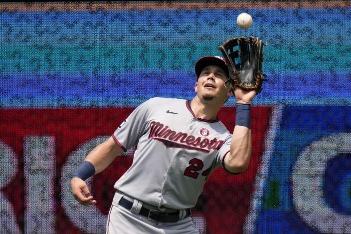 Minnesota Twins left fielder Trevor Larnach catches a fly ball for the out on Kansas City Royals' Ryan O'Hearn during the fourth inning of a baseball game Sunday, July 4, 2021, in Kansas City, Mo. (AP Photo/Charlie Riedel)