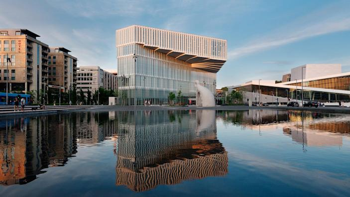 Oslo's new Deichman Bjørvika Public Library features a bold cantilevered facade that juts out over the city's waterfront.