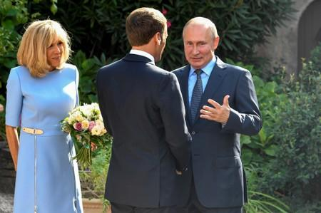 French President Emmanuel Macron and his wife Brigitte Macron welcome Russia's President Vladimir Putin, at the French President's summer retreat of the Bregancon fortress on the Mediterranean coast, near the village of Bormes-les-Mimosas