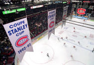 FILE - This Feb. 22, 1996, file photo shows some of the banners hanging from the rafters of the Montreal Forum marking the 24 Stanley Cup victories of the Canadiens, in Montreal. The Montreal Canadiens bid to end Canada's Stanley Cup drought brings back memories of the building in which they last won the title in 1993. The Montreal Forum still stands, but it's significance is beginning to fade. (AP Photo/Canadian Press via AP)