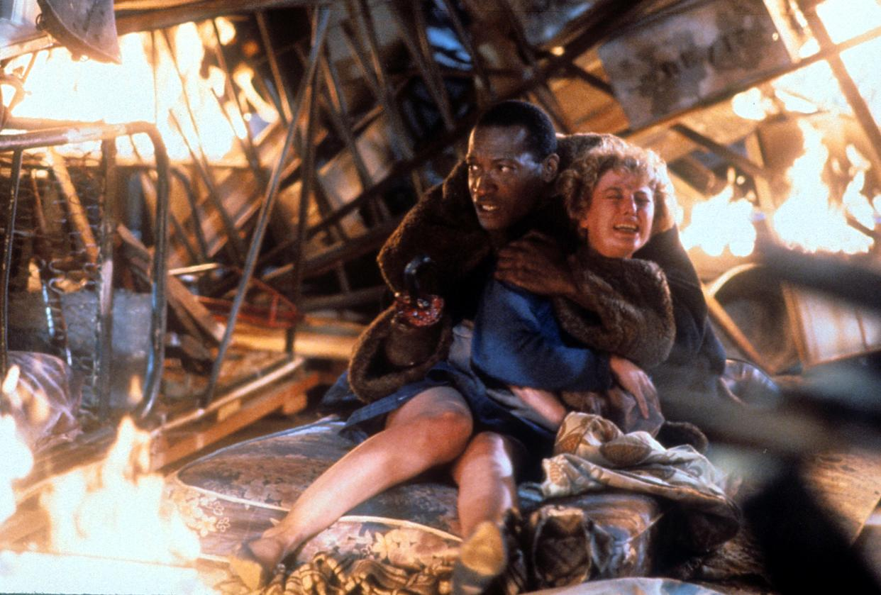 Tony Todd holds onto Virginia Madsen in a scene from the film 'Candyman', 1992. (Photo by TriStar/Getty Images)