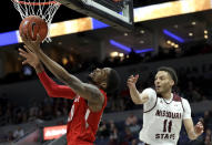 Bradley's Elijah Childs heads to the basket as Missouri State's Jarred Dixon (11) defends during the second half of an NCAA college basketball game in the quarterfinal round of the Missouri Valley Conference tournament, Friday, March 8, 2019, in St. Louis. Bradley won 61-58. (AP Photo/Jeff Roberson)