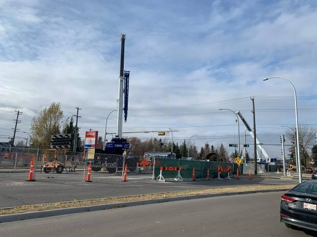 The intersection of 61st Avenue and 109th Street, where work is ongoing to repair a sewer trunk line more than 20 metres underground. (Travis McEwan/CBC - image credit)