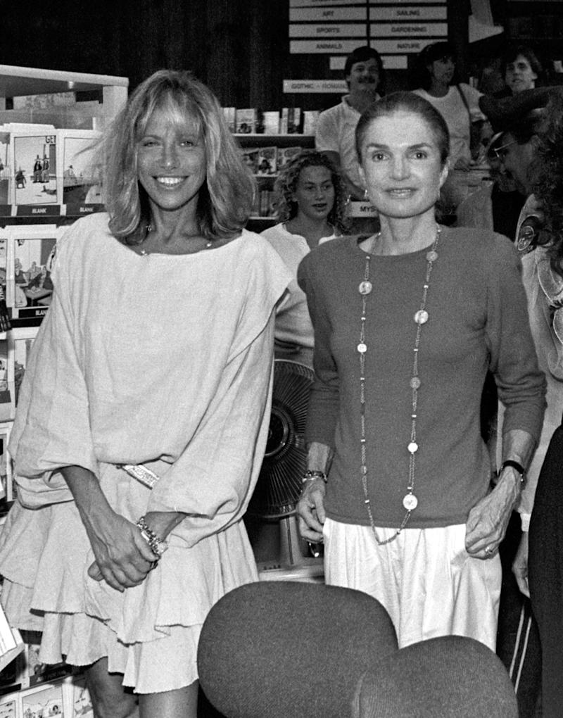 Good friends Carly Simon and Jackie Onassis pose for a picture at Bunch of Grapes Bookstore on Martha's Vineyard, Massachusetts, 9/2/89. Photo by Stephen Rose (Photo by Stephen Rose/Getty Images)
