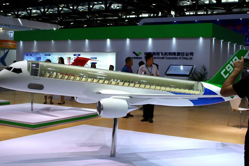 FILE PHOTO: A model of C919 passenger jet by COMAC is displayed at Aviation Expo China 2017 in Beijing
