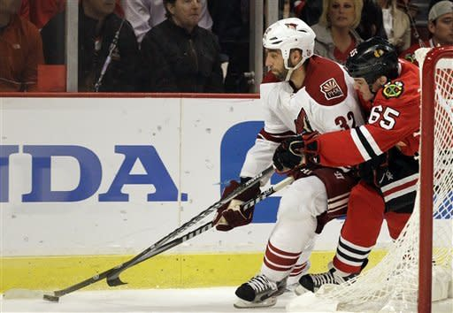 Phoenix Coyotes' Michal Rozsival (32) controls the puck against Chicago Blackhawks' Andrew Shaw (65) during the second period of Game 6 of an NHL hockey Stanley Cup first-round playoff series in Chicago, Monday, April 23, 2012. (AP Photo/Nam Y. Huh)