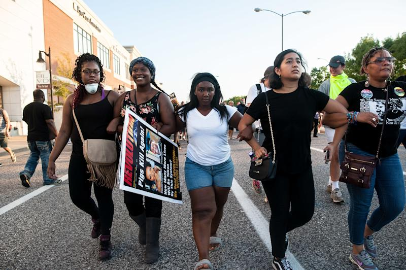 Protesters attempt to retake ground on Brentwood Boulevard in St. Louis after flanking the police line to find a route to the highway.