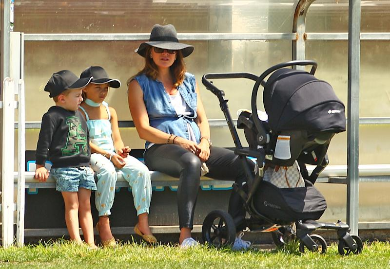 Michelle Bridges with her baby Axel in his pram looks on with Ella and Jack, the children of Steve Willis, also known as The Commando during the Medibank Melbourne Celebrity Twenty20 match at North Port Oval on February 21, 2016 in Melbourne, Australia.