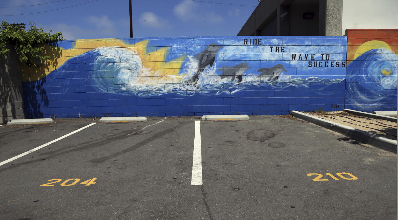 In this Friday, July 13, 2018 photo, an inspirational mural adorns a parking lot that doubles as a basketball court and soccer pitch at Animo Westside Charter Middle School during a summer session to introduce new students to the school they will attend in the fall, in the Playa Del Rey area of Los Angeles. Animo is one of many schools to benefit from donations by billionaires that are influencing state education policy by giving money to state-level charter support organizations to sustain, defend and expand the charter schools movement across the country. (AP Photo/Reed Saxon)
