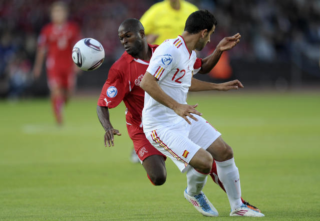Innocent Emeghara of Switzerland (center) vies with Martin Montoya (L) of Spain during the UEFA Under-21 European Championship final football match at NRGI Park Stadium in Arhus Stadion Denmark on June 25, 2011. AFP PHOTO CLAUS FISKER/SCANPIX (Photo credit should read CLAUS FISKER/AFP/Getty Images)