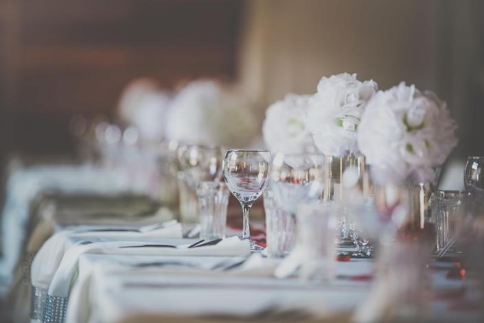 A decorated dinner table at a wedding