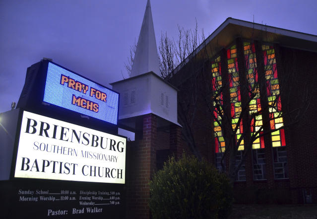 <p>A sign at Briensburg Baptist Church asks people to pray for the victims of the shootings at Marshall County High School, Jan. 23, 2018, near Benton, Ky. A prayer vigil was held at the church. (Photo: Stephen Lance Dennee/AP) </p>