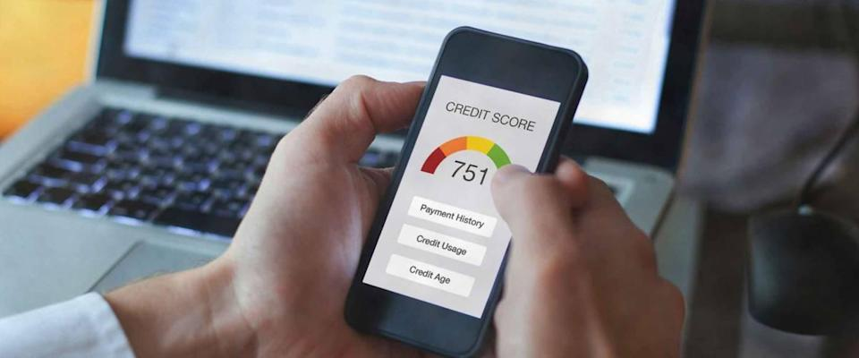 credit score concept on the screen of smartphone, checking payment history and ranking in bank