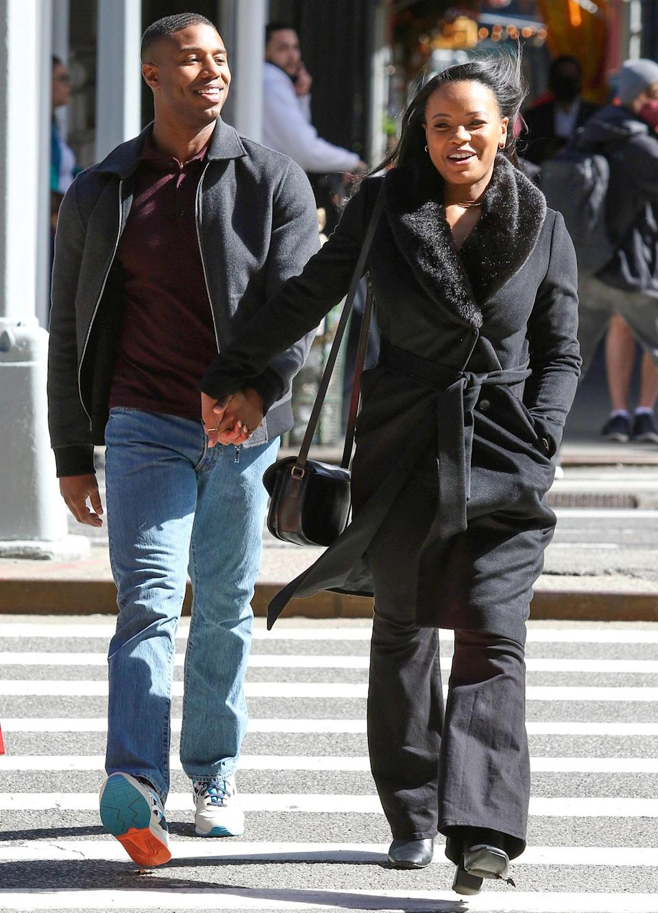 <p>Michael B. Jordan and Chante Adams walk hand-in-hand outside Rothmans Mens Clothing Store in New York City's Union Square on Friday while shooting scenes for their new film. </p>