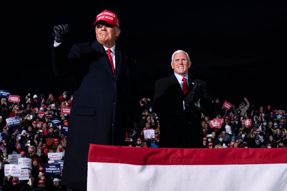 President Donald Trump and Vice President Mike Pence arrive for a campaign rally at Cherry Capital Airport, Monday, Nov. 2, 2020, in Traverse City, Mich. (AP Photo/Evan Vucci)