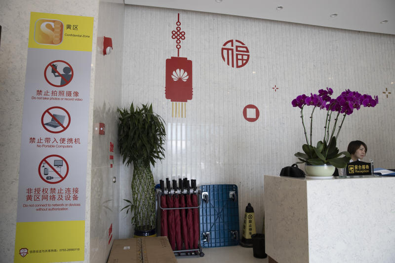 In this Aug. 21, 2019, photo, restriction notices are prominently displayed at the entry to a Huawei lab in Dongguan in Southern China's Guangdong province. Facing a ban on access to U.S. technology, Chinese telecom equipment maker Huawei is showing it increasingly can do without American components and compete with Western industry leaders in pioneering research. (AP Photo/Ng Han Guan)
