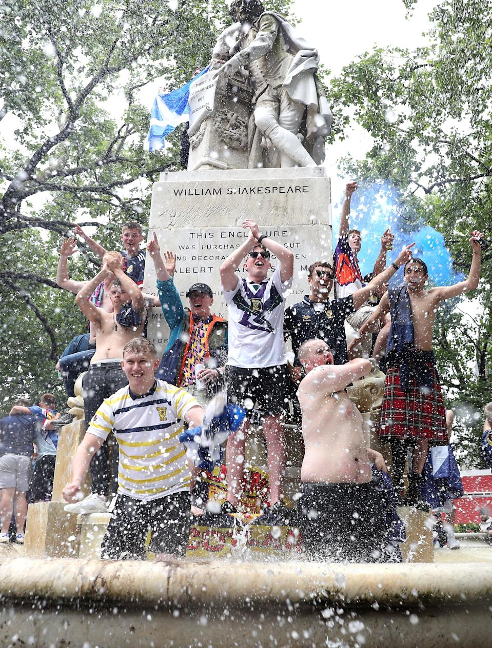 The weather didn't stop fans leaping into London fountains. (PA)